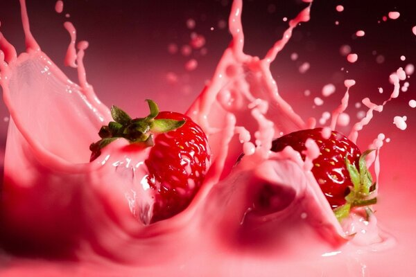 Strawberry falling into a yogurt