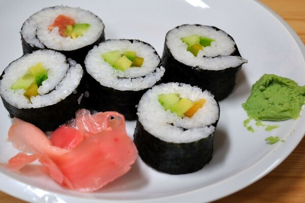 Sushi, rolls, vegetables and a piece of ginger