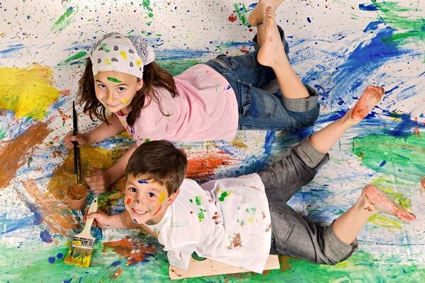 Boy and girl playing in the paint