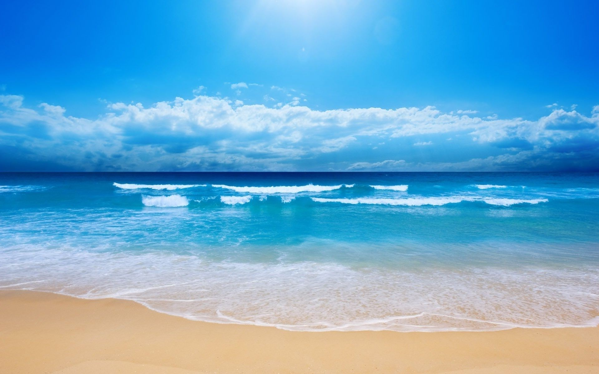 sea and ocean sand water tropical beach summer sun surf travel fair weather sea seashore seascape sky ocean nature relaxation turquoise idyllic vacation