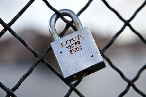 the lock on the fence \ Love never ends\