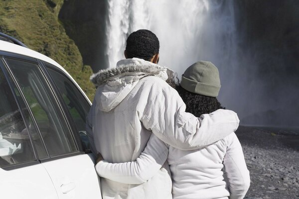 couple looking at waterfall