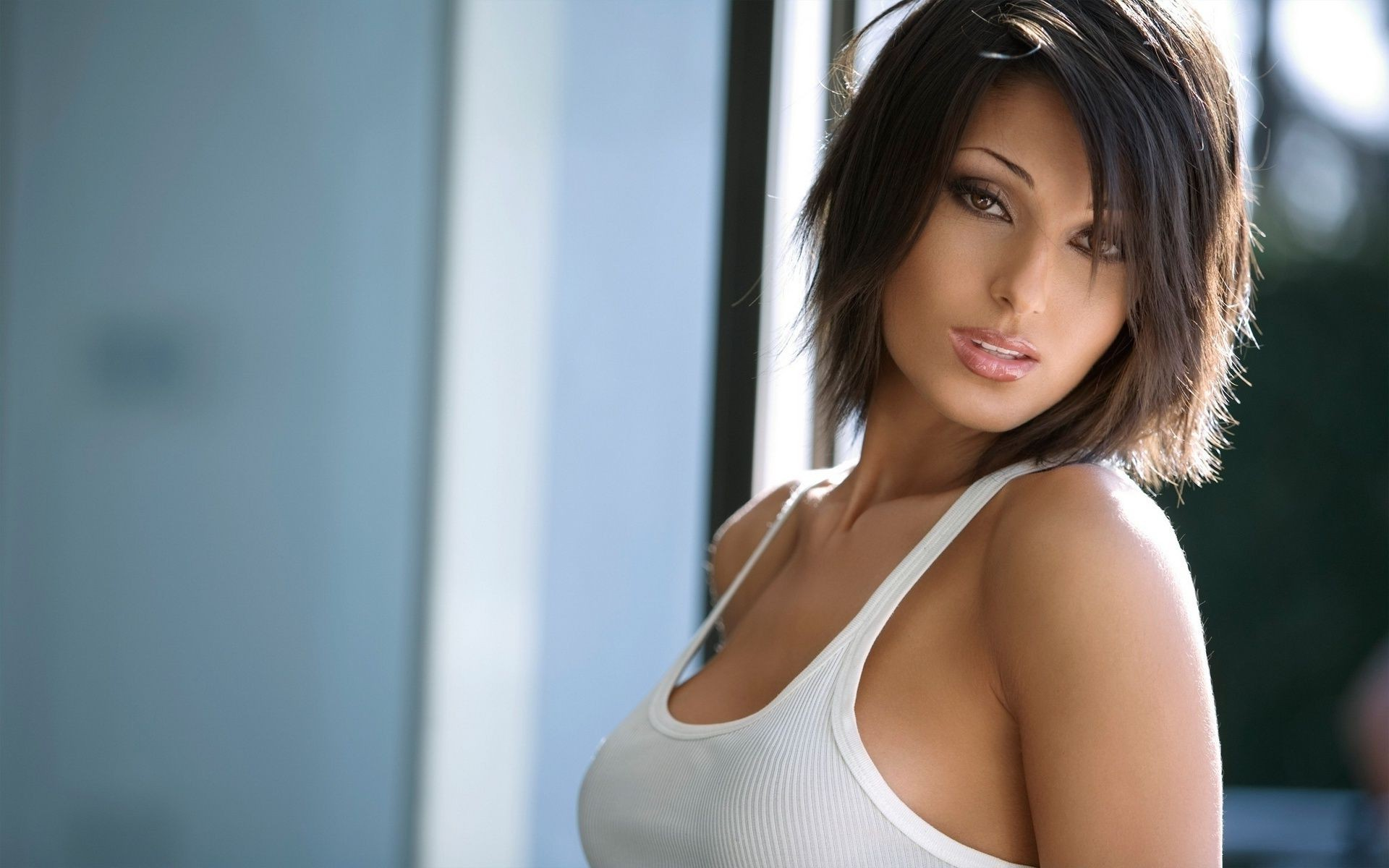 Cute girl with large Breasts in a white t-shirt