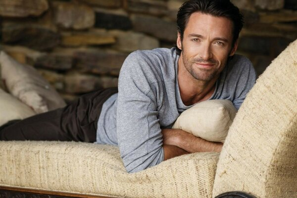 Hugh Jackman actor the glance, the smile on the sofa