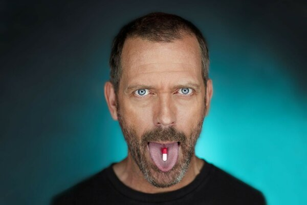 House m.d. tablet on the tongue Hugh Laurie of kravljaca blue g