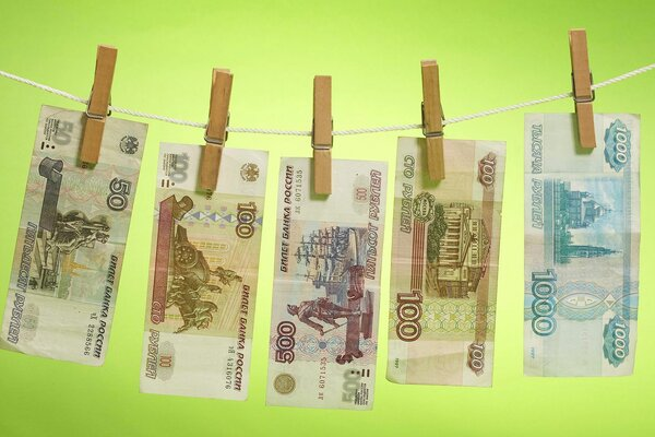 money roubles banknotes drying clothespins rope