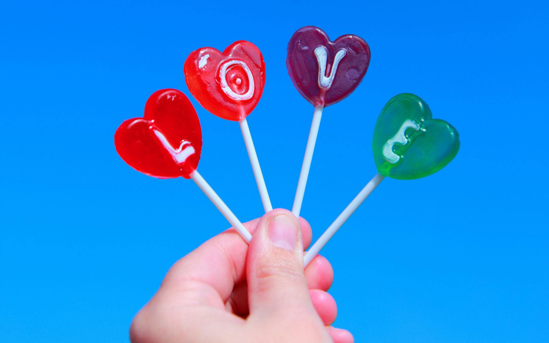 lollipops inscription letter love hand love the sky
