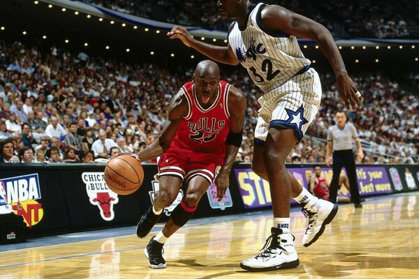 Game Chicago Bulls. Basketball player Michael Jordan does pass