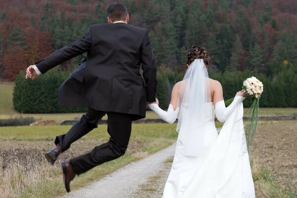 Walk the newlyweds. The man jumped for joy