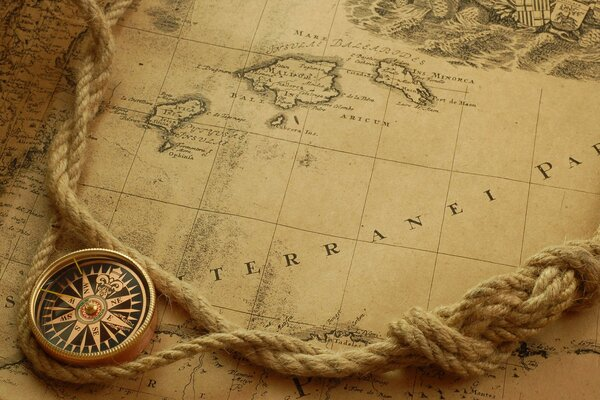 The compass lies on a nautical map