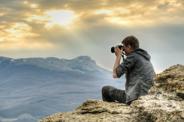 The guy s a photographer in the mountains