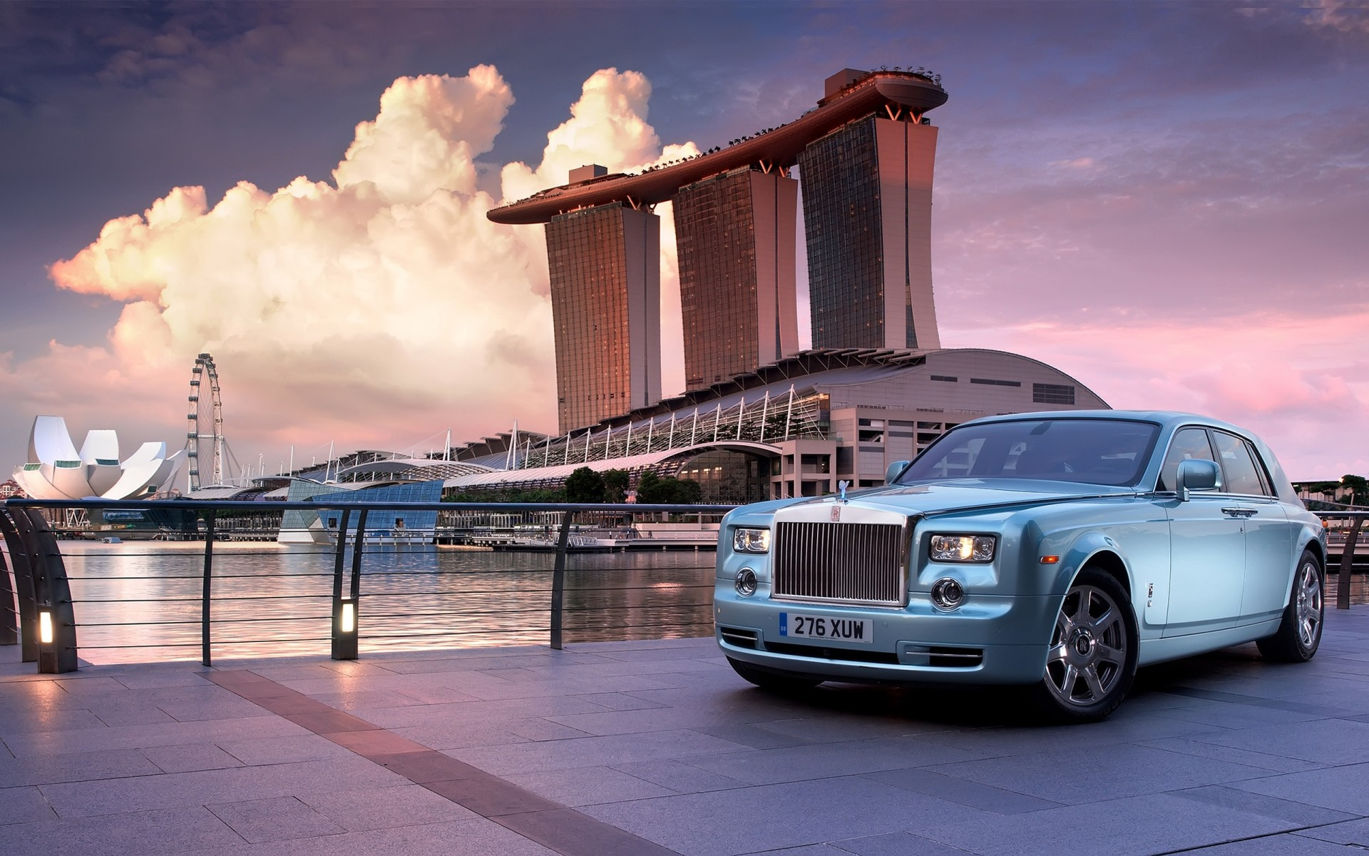 rolls royce vehicle architecture travel transportation system water bridge city sunset sky car building dusk outdoors downtown business urban