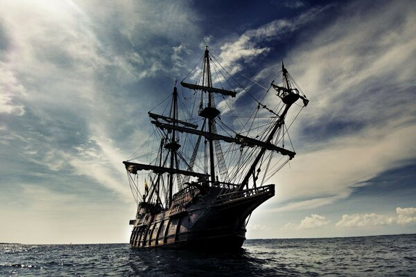 Ship Galleon sailing sea waves sky clouds landscape