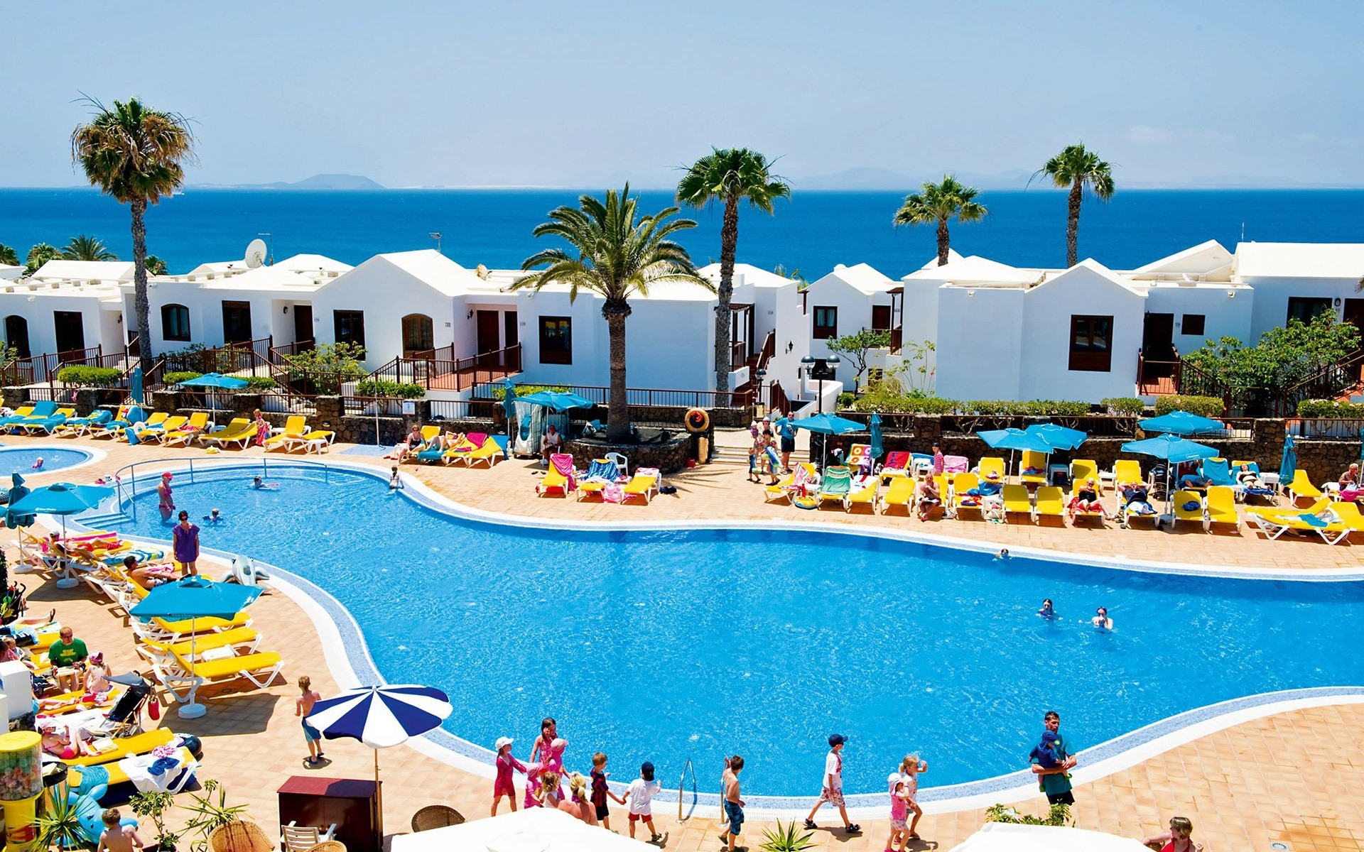spain resort swimming pool swimming vacation pool water travel hotel umbrella leisure seashore beach summer poolside sea chair luxury recreation tropical tourism