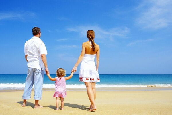 A family with a child on the seashore