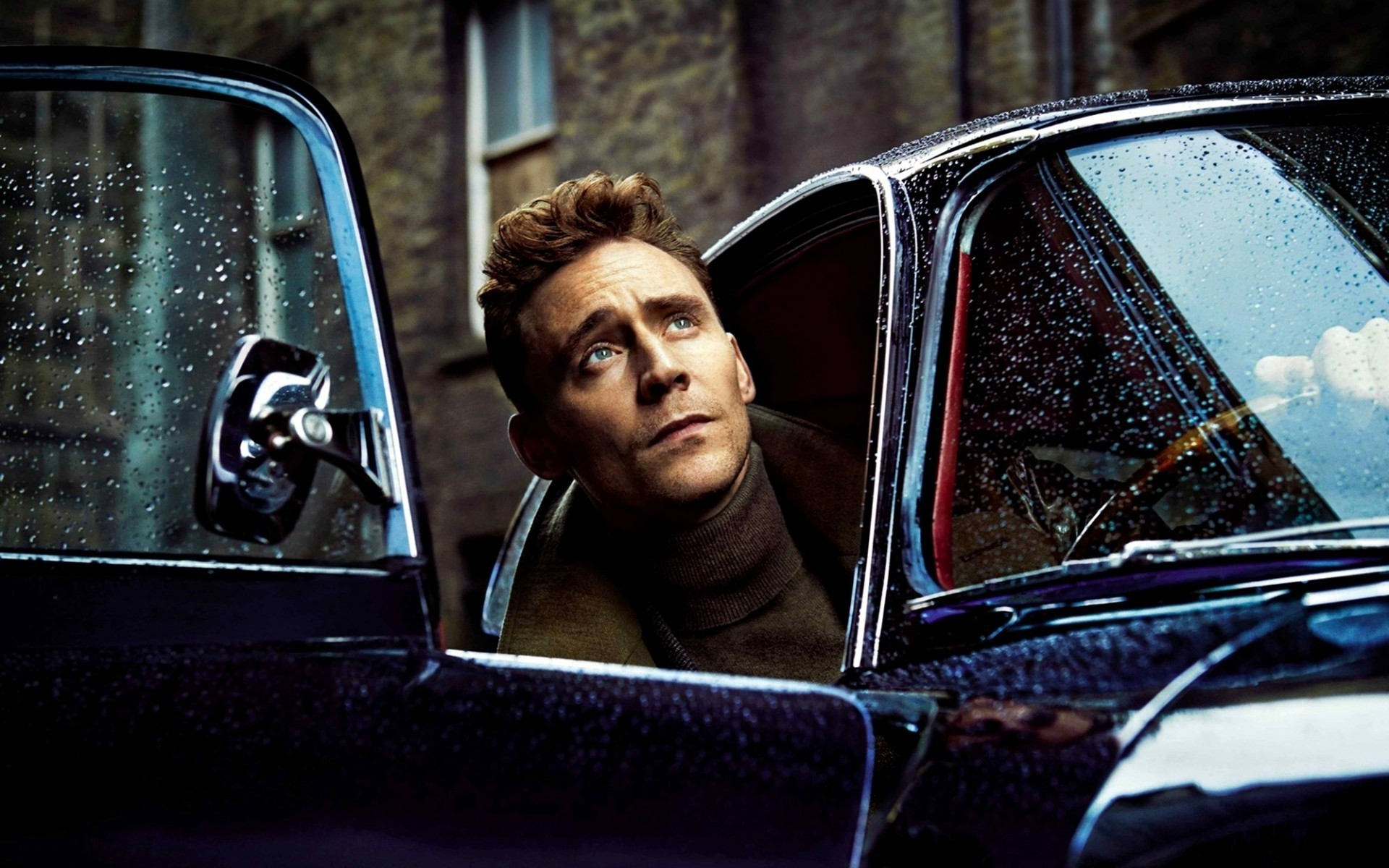 men car vehicle transportation system one adult woman window driver man windshield indoors facial expression portrait tom hiddleston