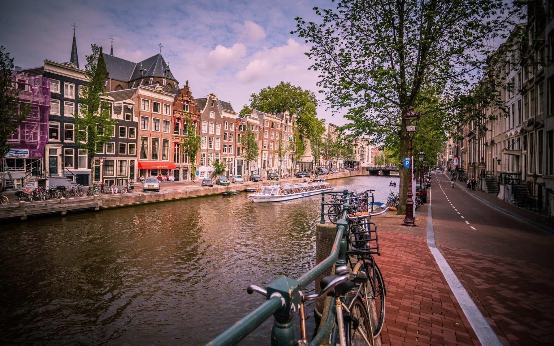 other city canal city architecture building travel water river street urban town bridge house tourism outdoors old sight reflection sky amsterdam landscape boat