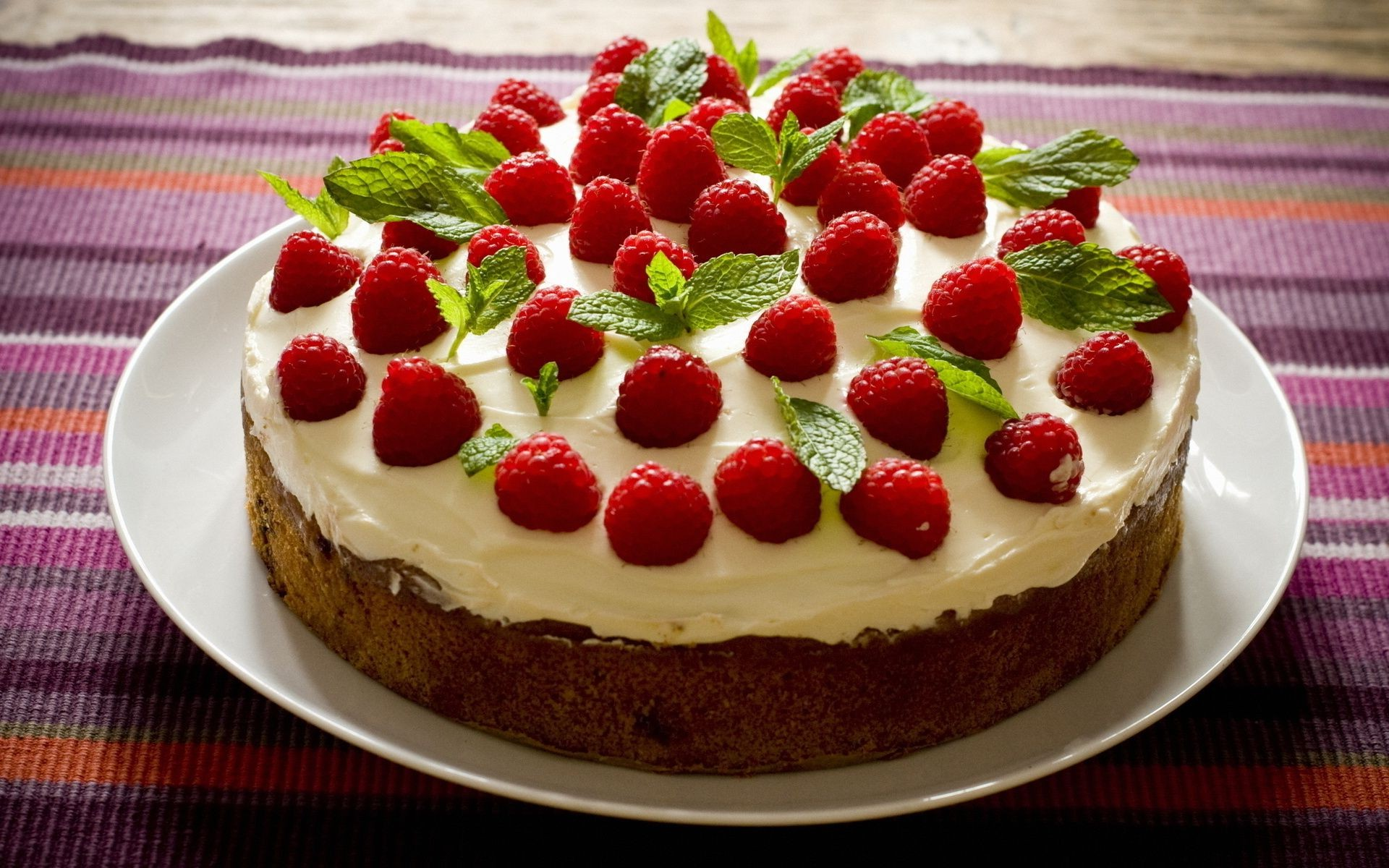 cake The definition of cake is a sweet dessert made from flour, eggs, sugar and other ingredients that is round or square and that is baked, or a flat mass of food that is baked or fried to form into a hard mass or a crust solidify or encrust.