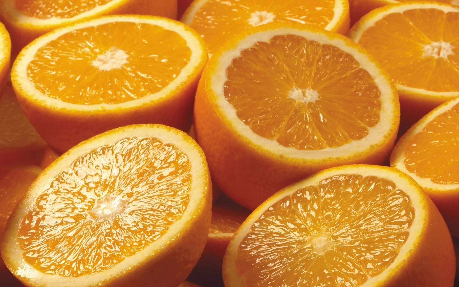 A whole bunch of halves of oranges