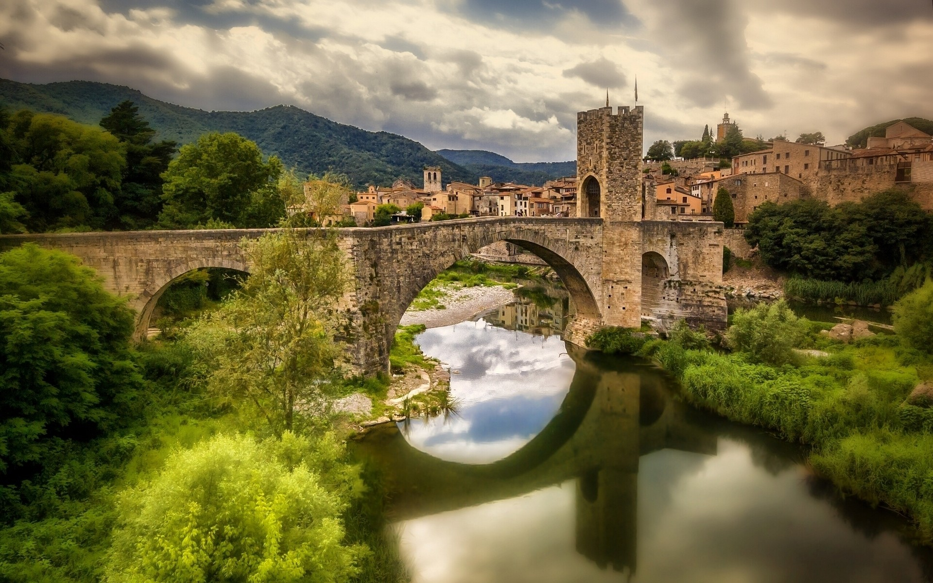 spain architecture travel bridge castle river water gothic ancient old landscape sky outdoors building city tree stone tower besalu bridge catalonia