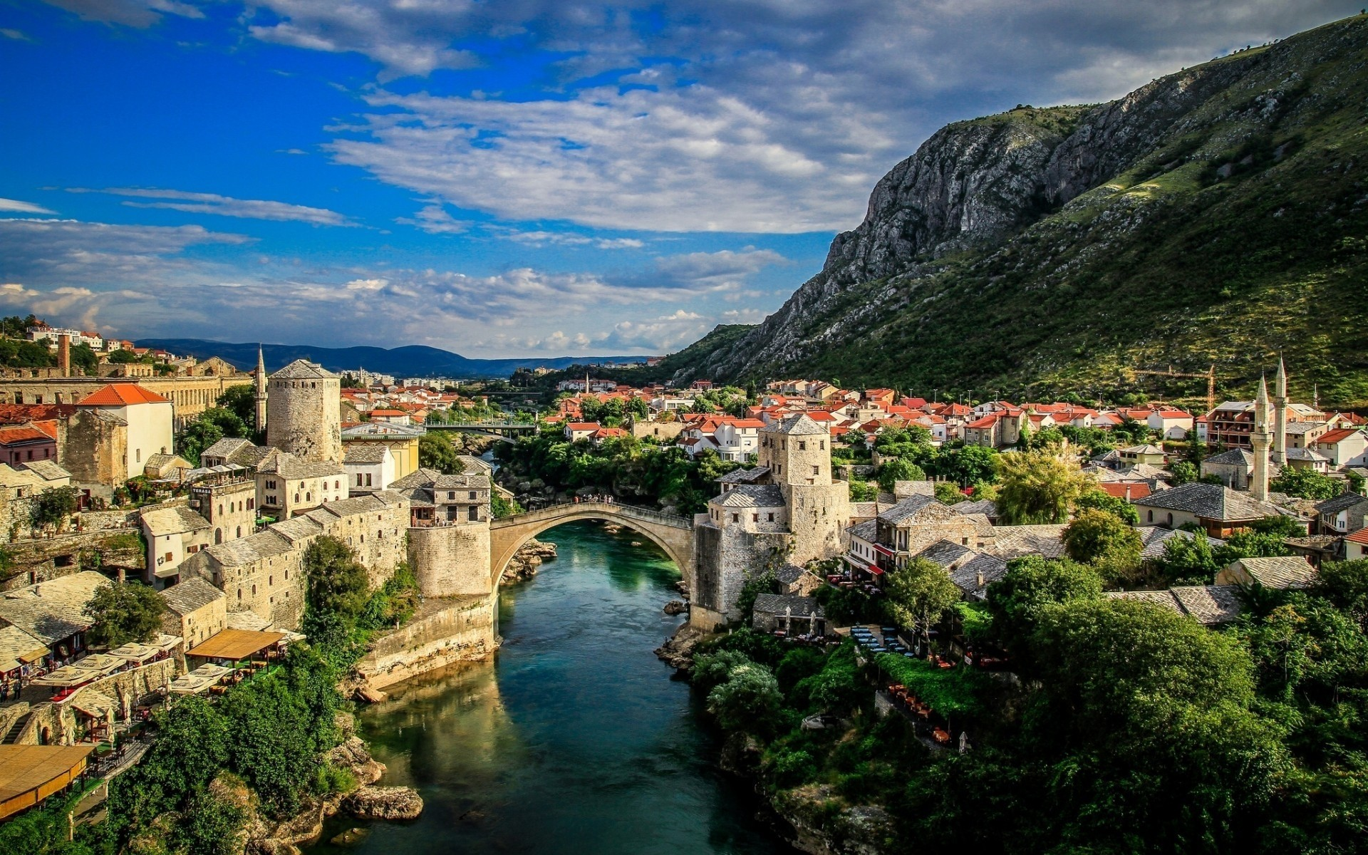 other city architecture travel town city water landscape church house building tourism river sight cityscape hill seashore panoramic fortress landmark old mostar bosna hercegovina