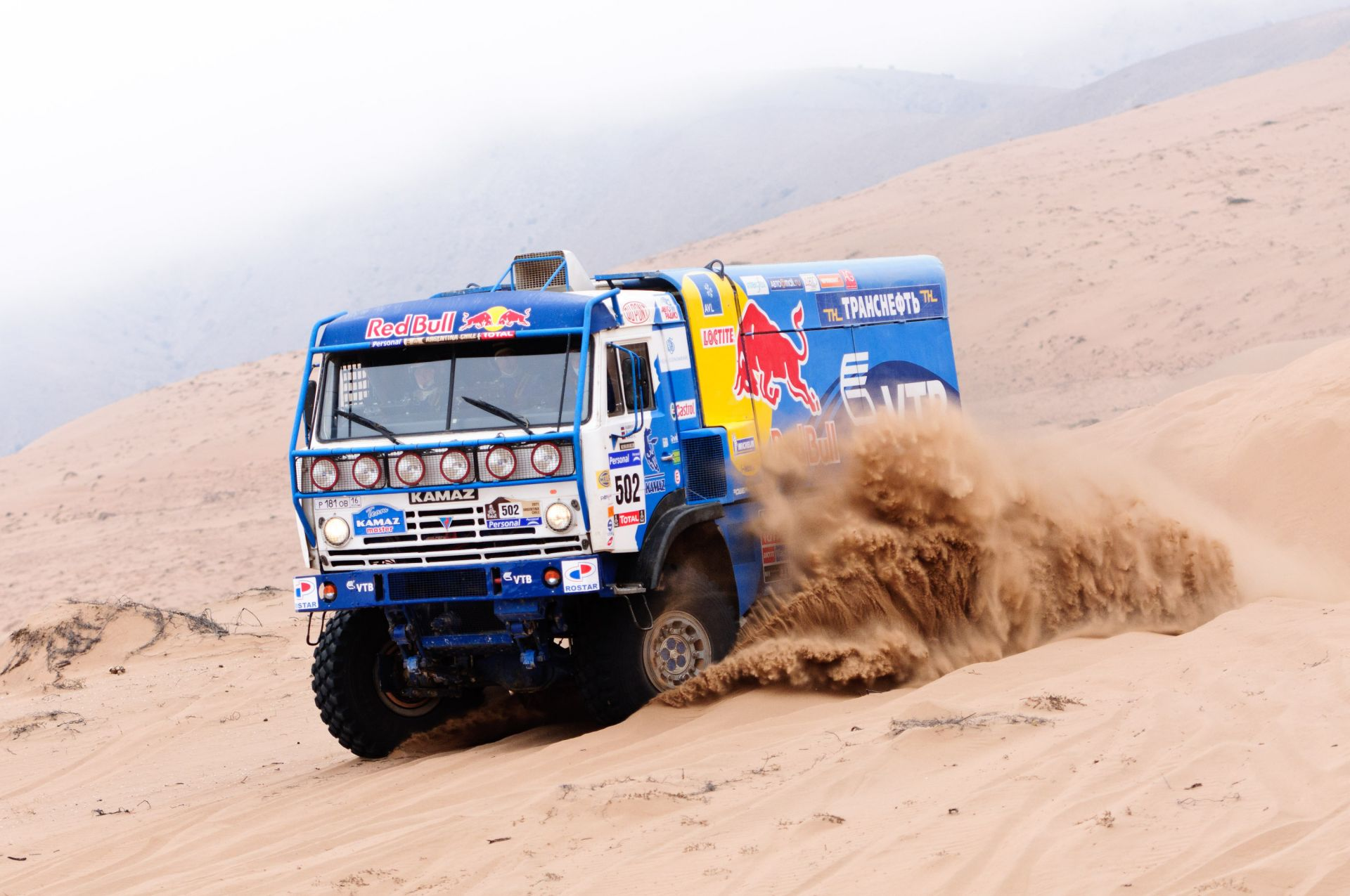 trucks sand vehicle dust truck rally race transportation system car soil travel track desert mud road adventure drive gravel wheel fast