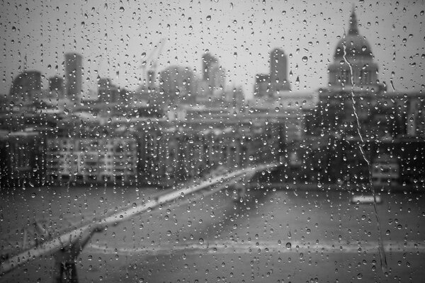 black Wallpaper photo rain Glass drops of the white city