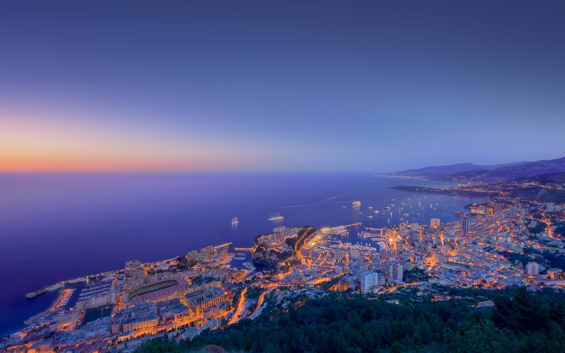 building lights ships Monaco coast of the sunset sea