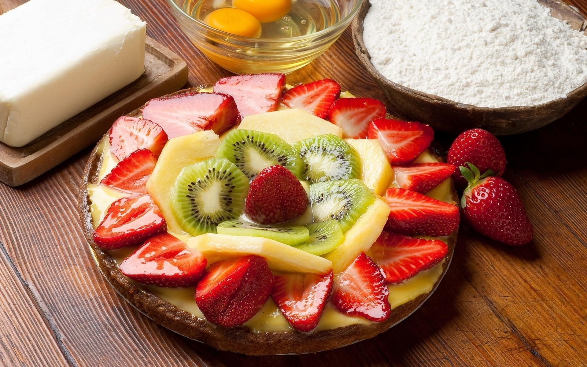 a Juicy pineapple dessert, eggs, strawberry slices kiwi