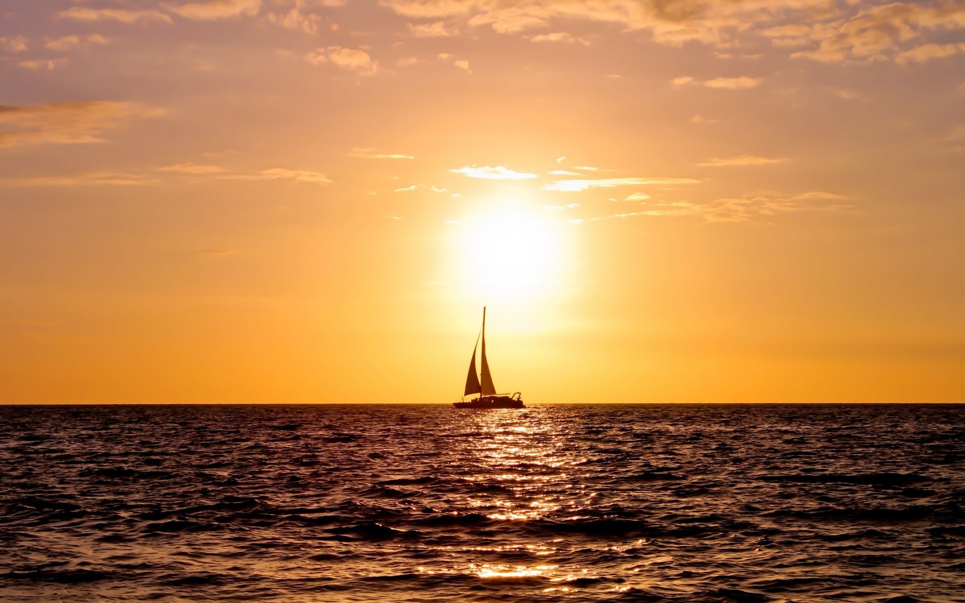 the sunset and sunrise sunset water sea dawn ocean sun boat dusk sailboat evening seascape beach watercraft sky reflection ship light summer