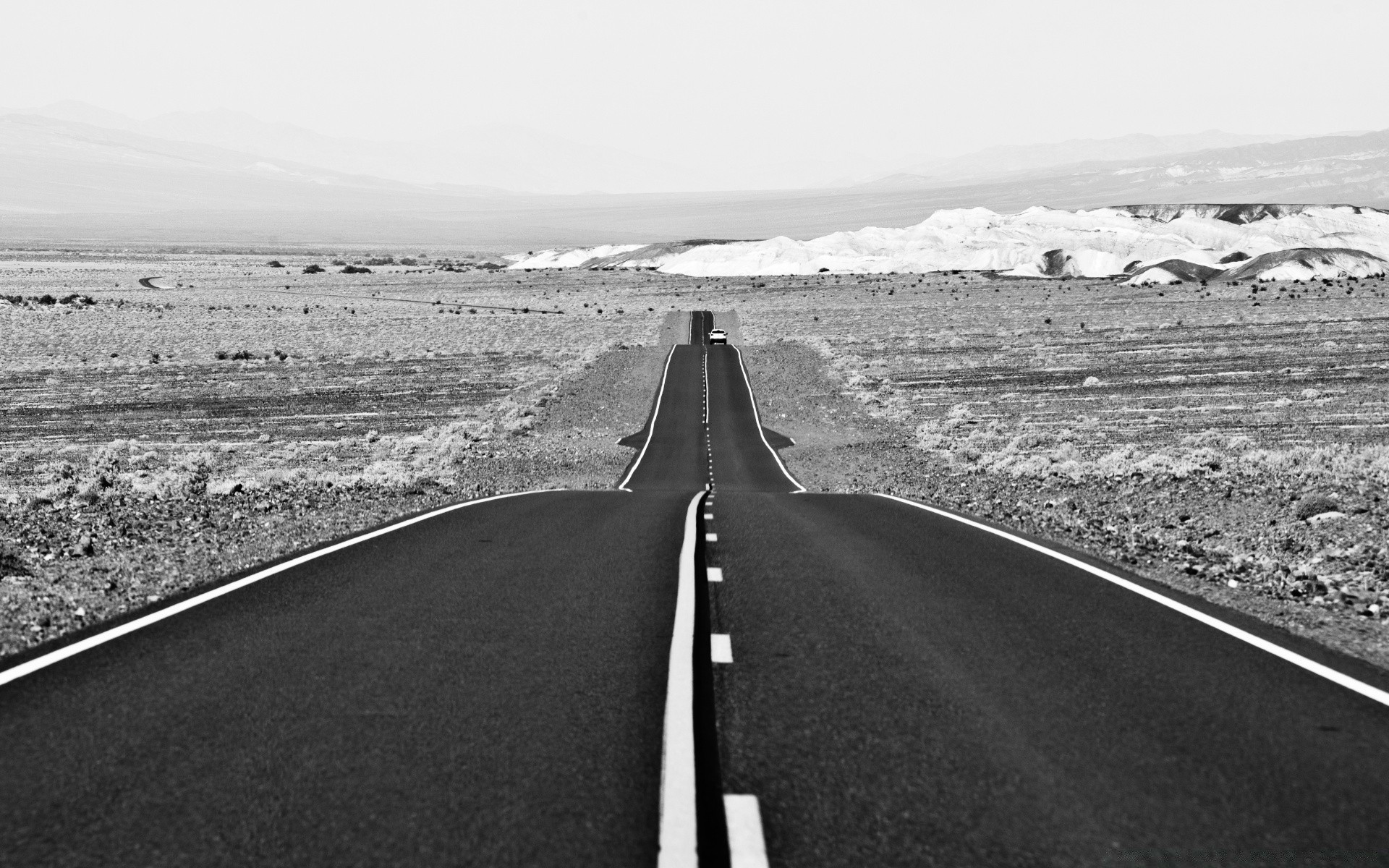 black and white highway road asphalt landscape travel transportation system street empty desert sky monochrome guidance expressway outdoors