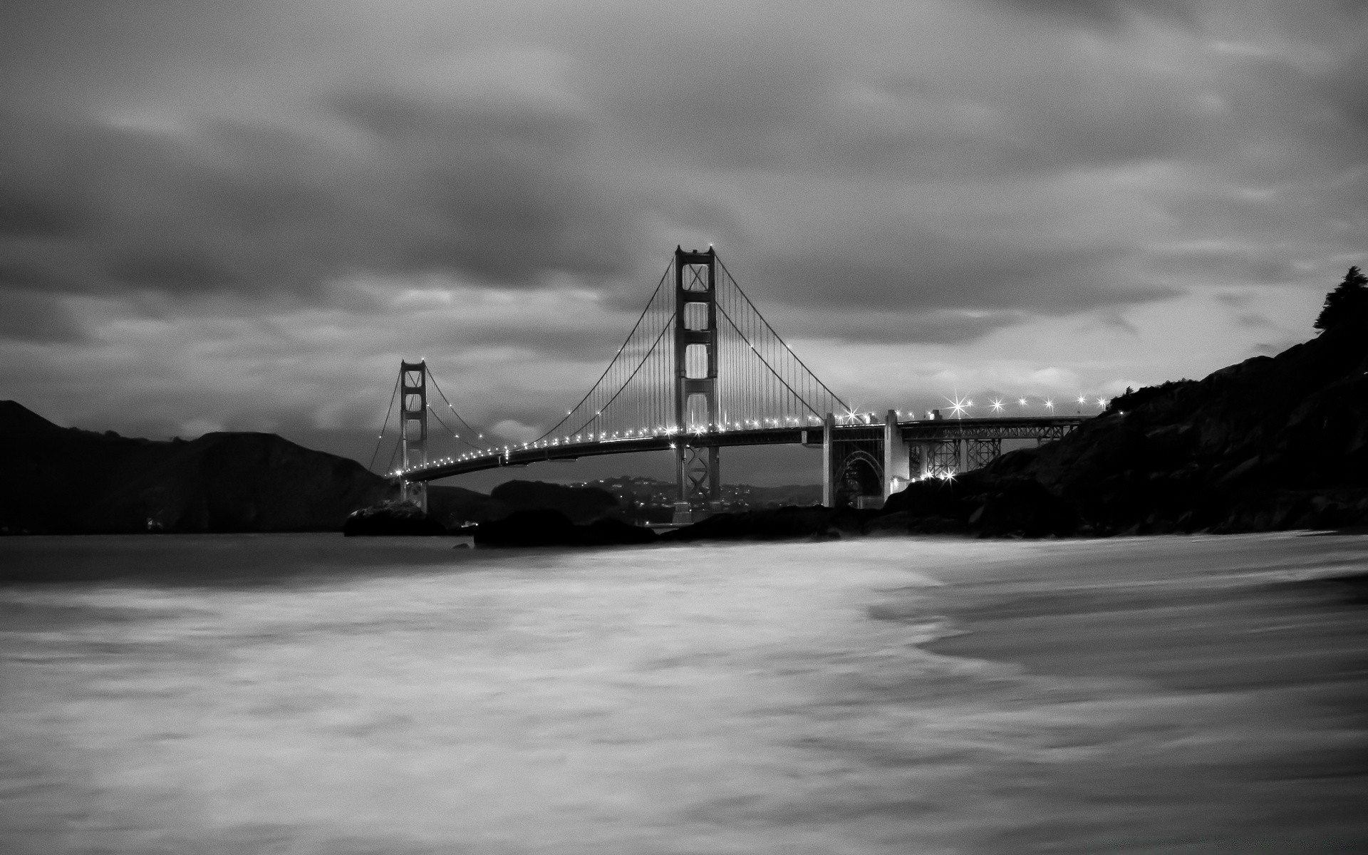 black and white water bridge transportation system vehicle monochrome sea suspension bridge ocean sunset river boat dawn watercraft beach landscape sky travel ship