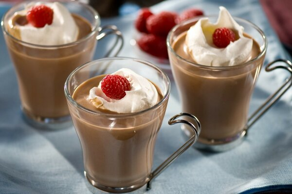 Raspberries On Cream Over Coffee