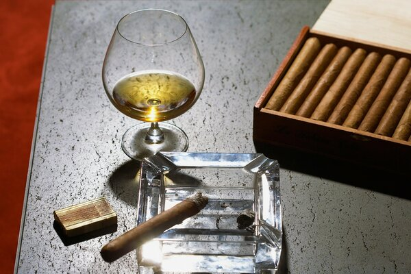 Close-Up Of Cognac Glass And Cigars