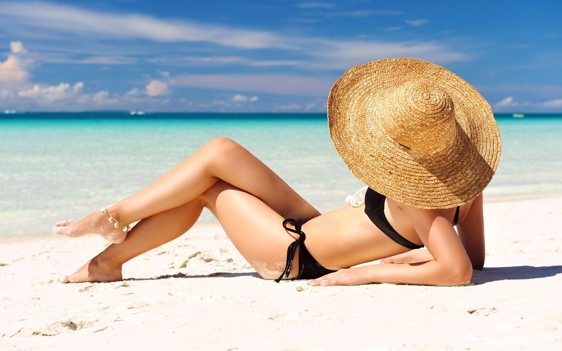 Sunbathing On The Beach Phone Wallpapers
