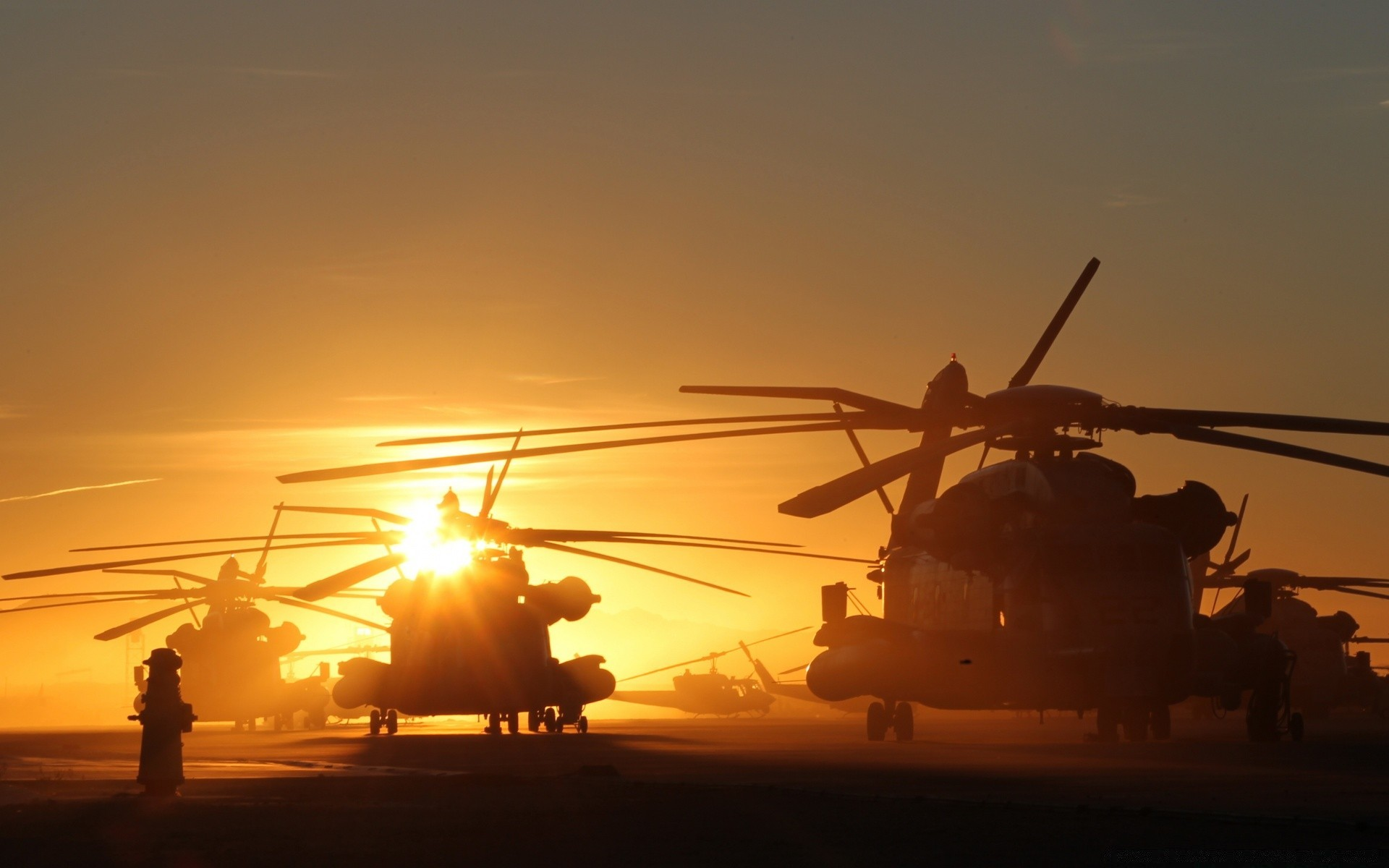 helicopters at sunset. android wallpapers for free.