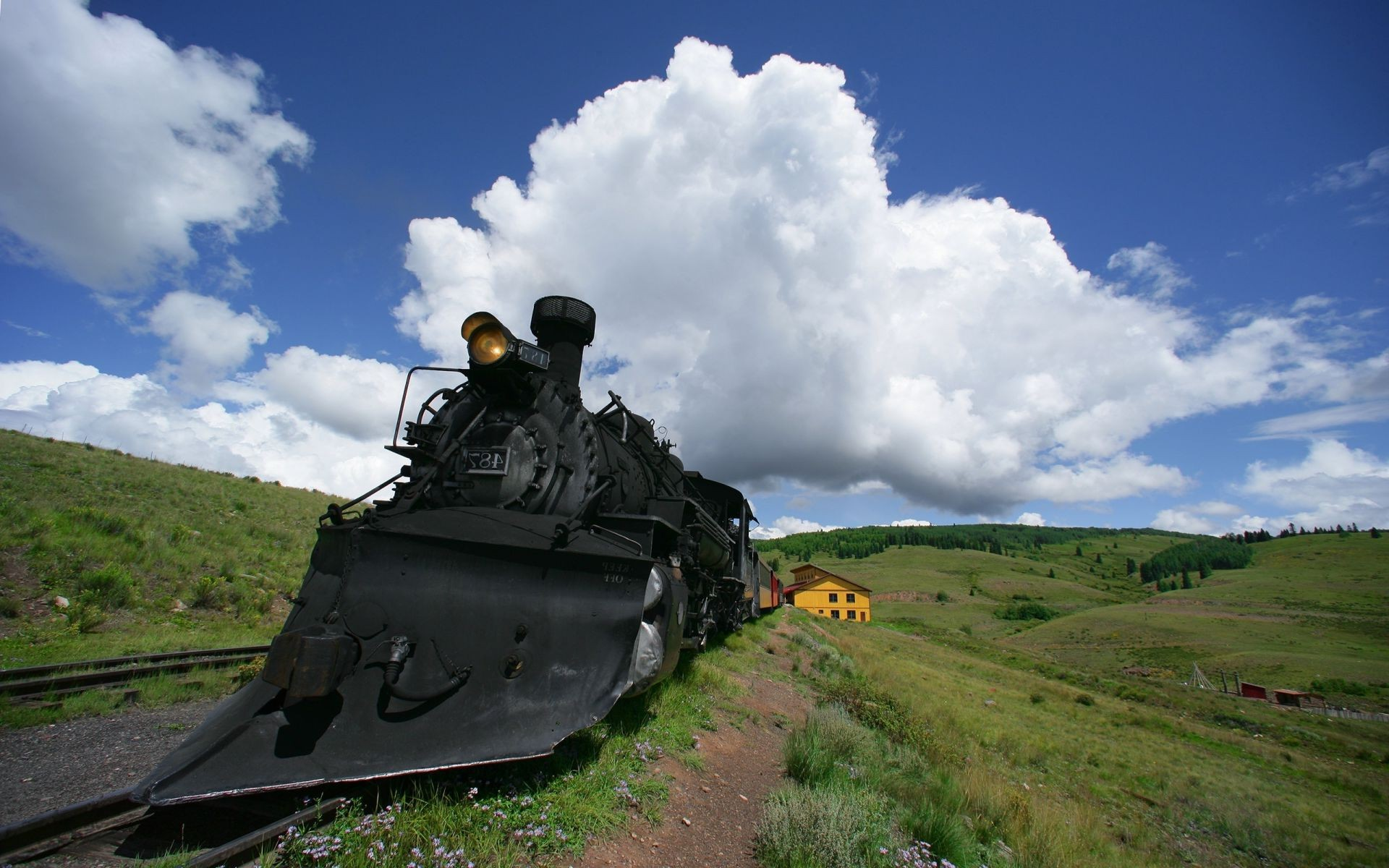 Iron steam road locomotive the clouds