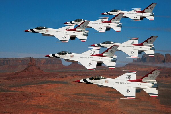 Thunderbirds Flying In Formation Over Monument Valley