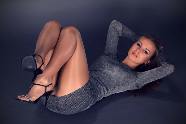 Girl shoes posing in dress pantyhose legs