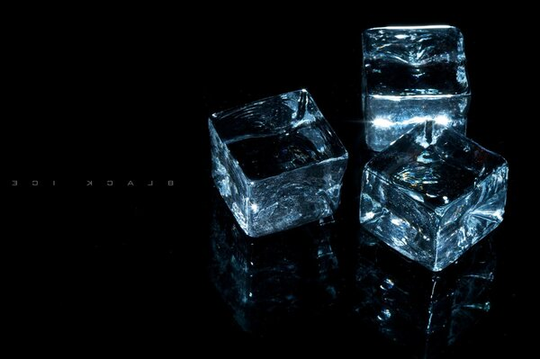 Cubes the transparency of the background of the three on the black ice