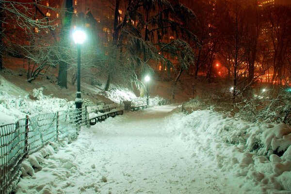 lantern night light Park building snow sidewalk Town
