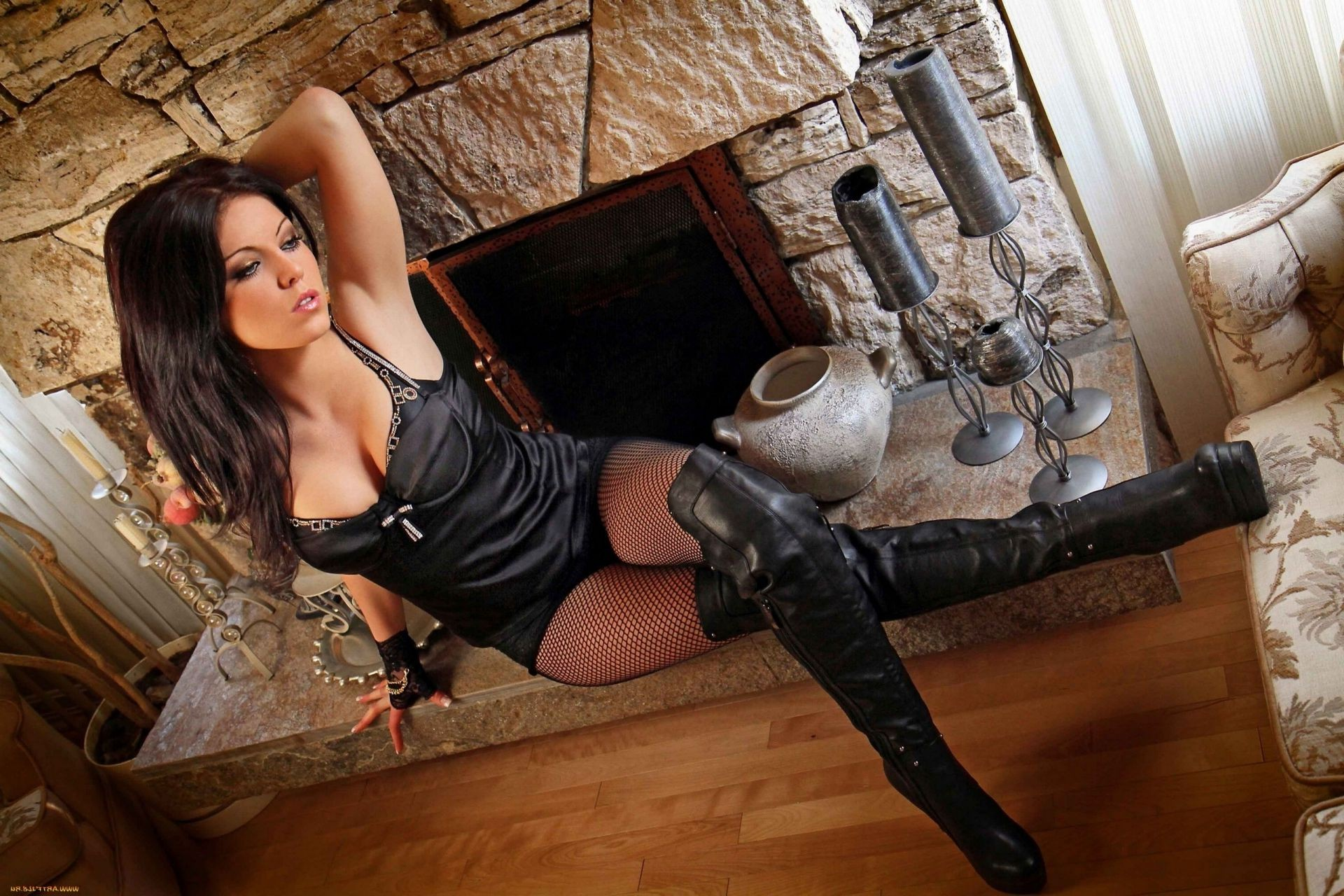 super beautiful girl by the fireplace