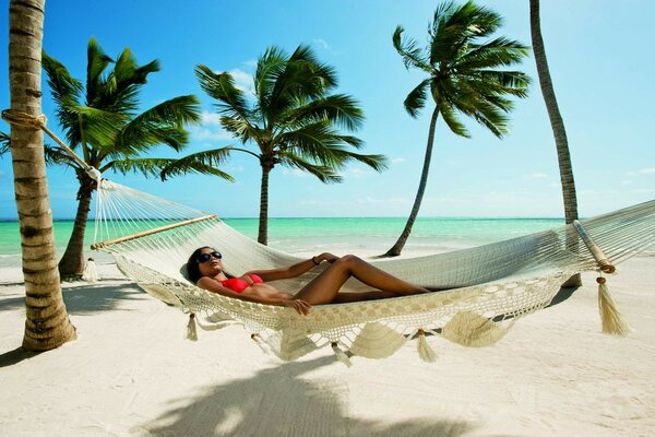 sea brunette bikini sunglasses hammock