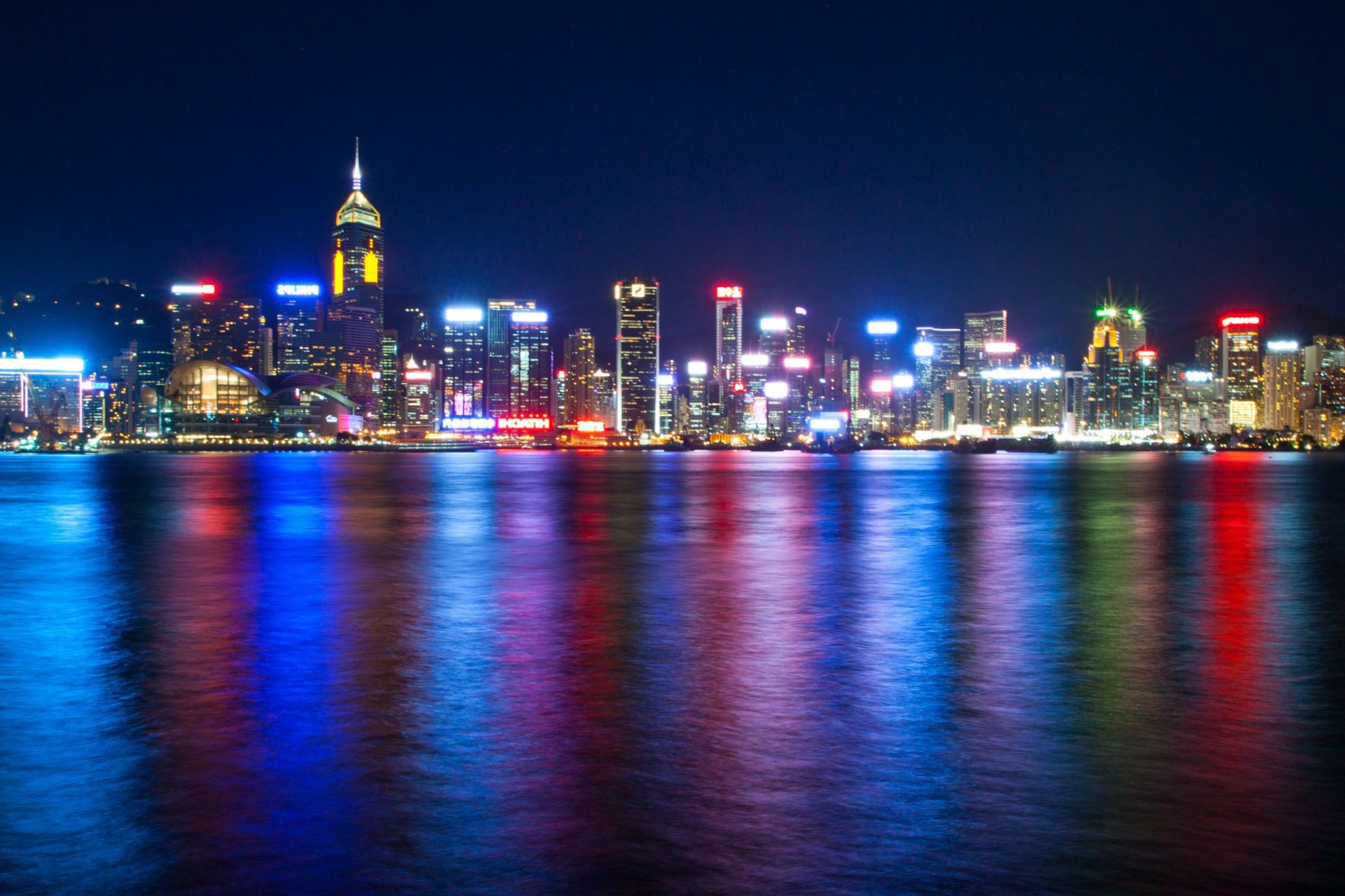 sea China night lights of the Victoria harbour Hong Kong