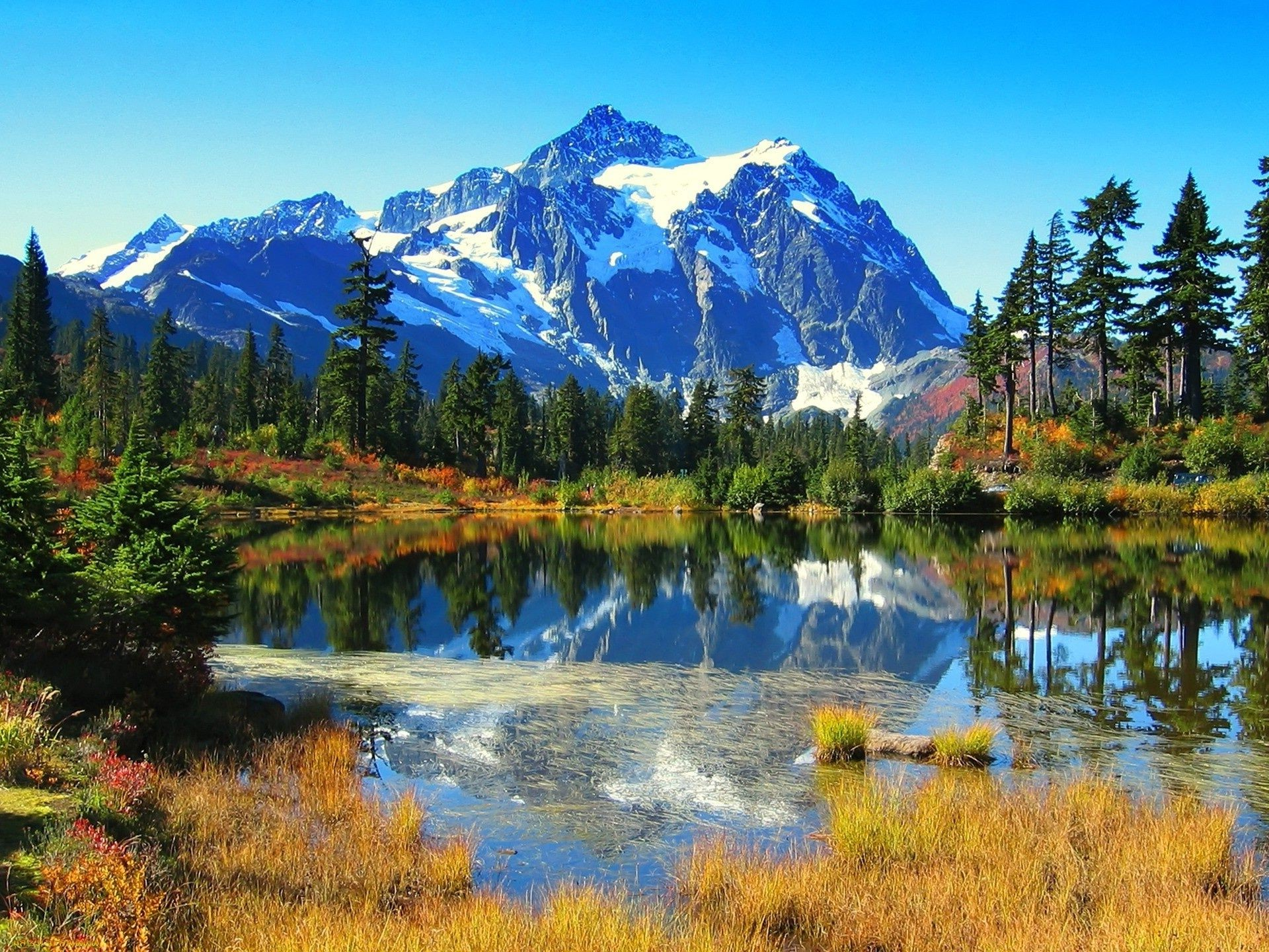 lake mountain reflection water snow scenic wood nature wild landscape outdoors travel evergreen