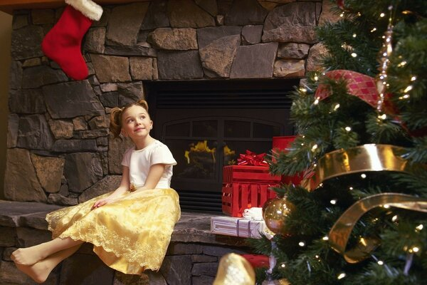 girl child waiting for Christmas gifts fireplace Christmas tree
