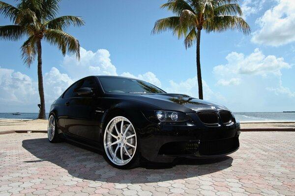 Black BMW near the beach in Miami