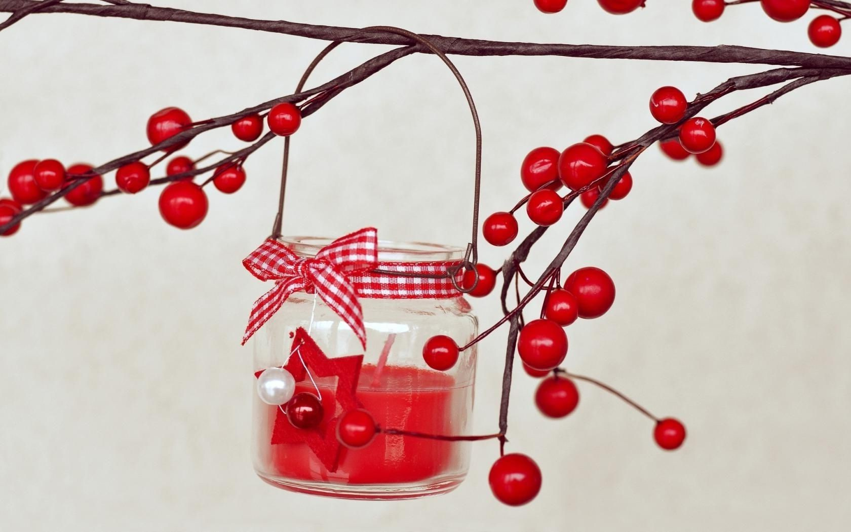 candle berries red branch bow
