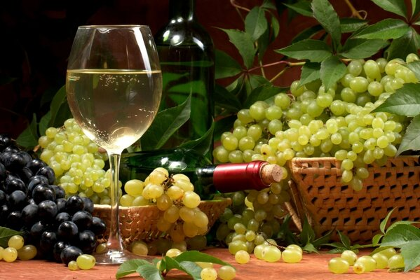 Wine bottle basket wine glass grapes leaves white