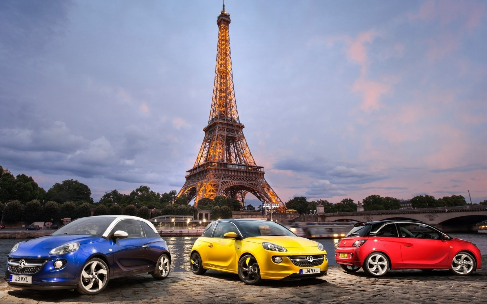 Three cars near the Eiffel tower in Paris